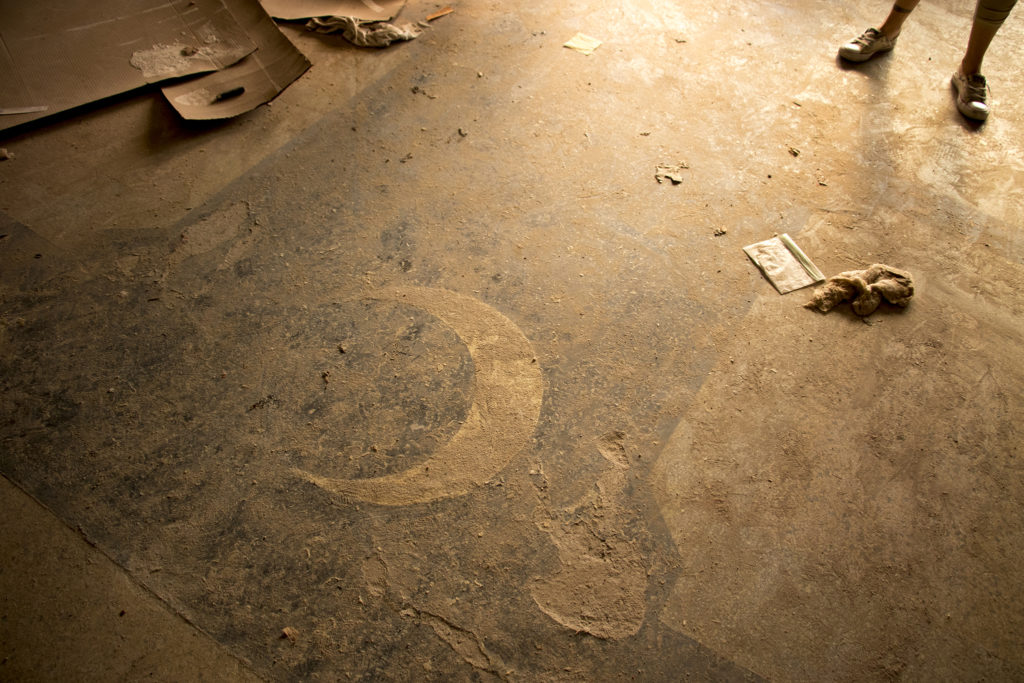 A moon on the floor of a historic theater on 44th Avenue in Berkeley that may be restored, Dec. 5, 2018. (Kevin J. Beaty/Denverite)
