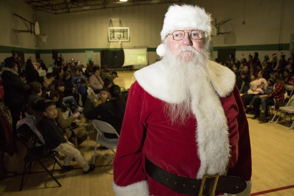 Dave Oletski plays Santa Claus at Focus Points' holiday fiesta at the Swansea Rec Center, Dec. 6, 2018. (Kevin J. Beaty/Denverite)