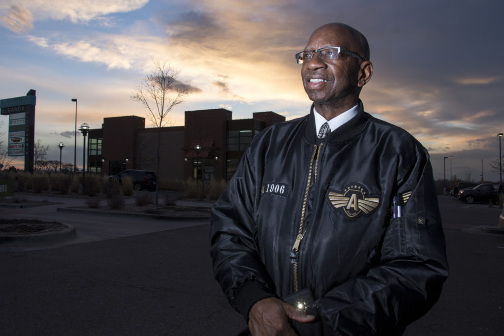 Tony Young poses for a portrait under a painted sky, Dec. 7, 2018. (Kevin J. Beaty/Denverite)
