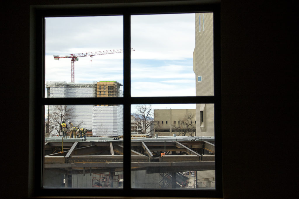 Construction on the Denver Art Museum's north building, seen from inside the Denver Public Library's main branch downtown, Dec. 12, 2018. (Kevin J. Beaty/Denverite)