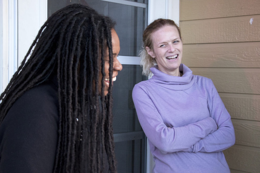 Ta'via Cook (left) and Ali Paledino chat with a reporter outside of their home in Green Valley Ranch, Dec. 14, 2018. (Kevin J. Beaty/Denverite)