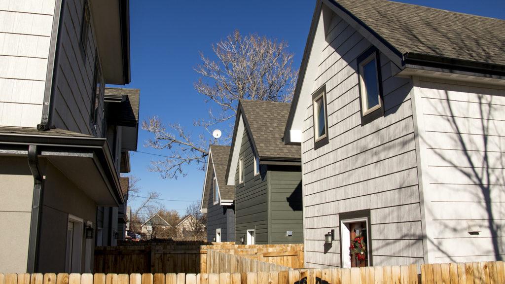 A trio of accessory dwelling units behind homes in Cole, Dec. 18. 2018. (Kevin J. Beaty/Denverite)