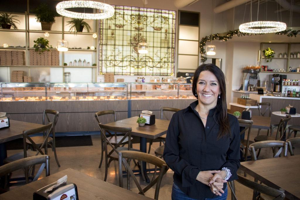 Maria Empanada owner Lorena Cantarovici in her new location on Platte Street, Dec. 18, 2018. (Kevin J. Beaty/Denverite)
