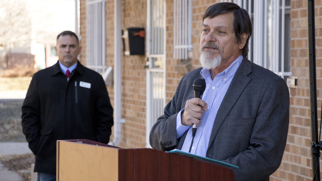 John Parvensky, CEO and President of Colorado Coalition for the Homeless,  speaks during groundbreaking for new housing for homeless veterans at the University of Colorado Hospital in Aurora, Dec. 18, 2018. (Kevin J. Beaty/Denverite)
