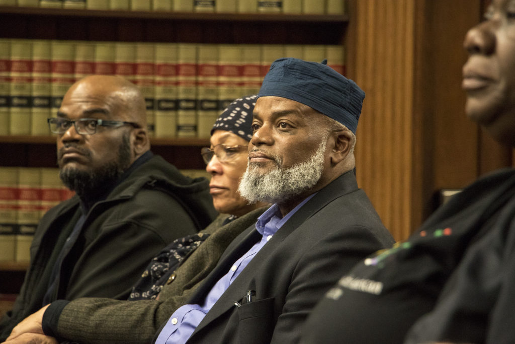 Imam Abdur-Rahim Ali, executive director of the  Northeast Denver Islamic Center, listens in during a Denver zoning committee meeting, Dec. 19, 2018. (Kevin J. Beaty/Denverite)