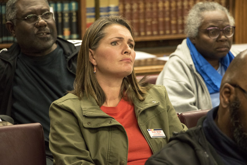 City Council District 8 candidate Blair Taylor listens in during a Denver zoning committee meeting, Dec. 19, 2018. (Kevin J. Beaty/Denverite)