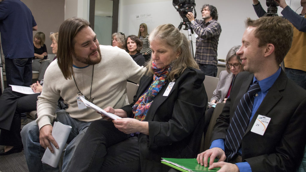 Ean Tafoya embraces Becky English after the Colorado Transportation Commission agreed to a settlement in the third and final lawsuit against the I-70 widening project, Dec. 20, 2018. (Kevin J. Beaty/Denverite)