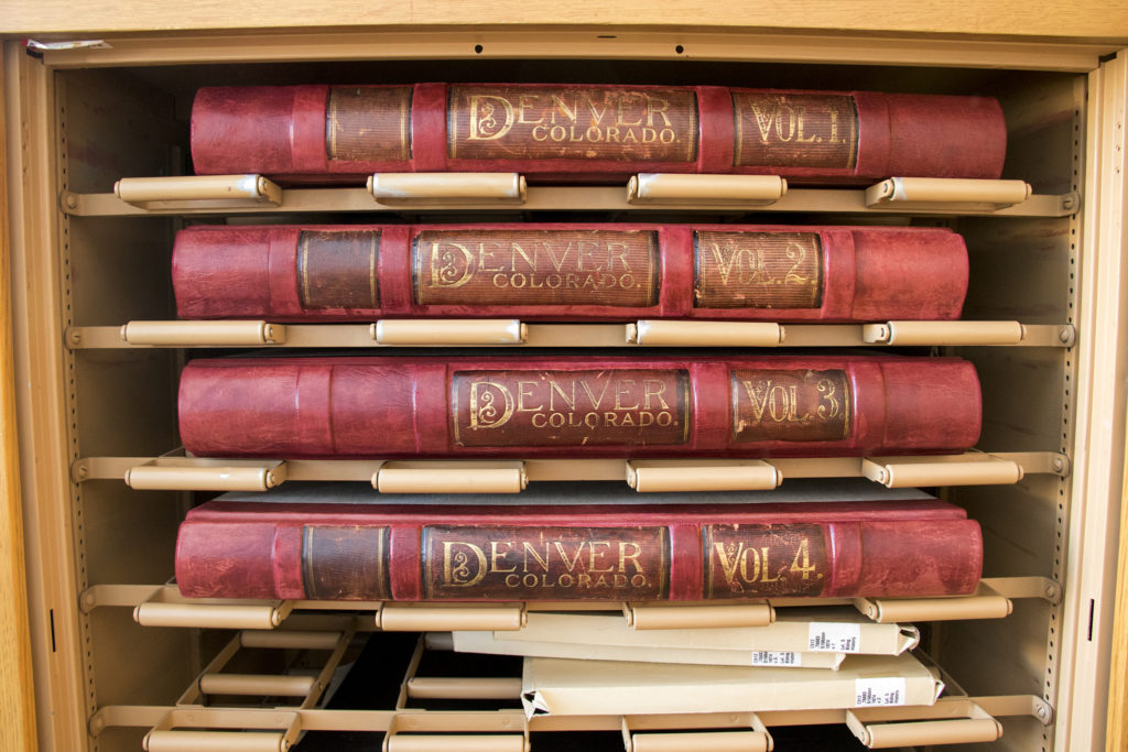 Volumes of Sanborn fire insuance maps at the Denver Public Library's Western History Collection, Dec. 20, 2018. (Kevin J. Beaty/Denverite)