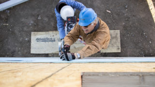 Jim Harfield (right) and Dave Boltz build a house at Habitat for Humanity's College View neighborhood site, Dec. 20, 2018. (Kevin J. Beaty/Denverite)