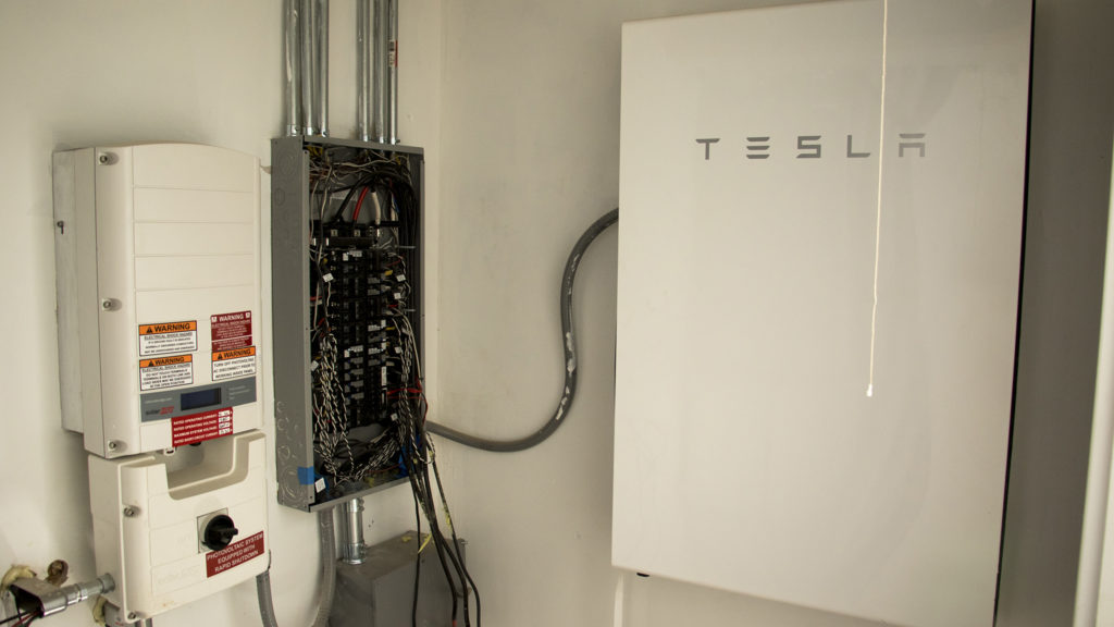 A big Tesla battery inside a solar home under construction at Habitat for Humanity's College View neighborhood site, Dec. 20, 2018. (Kevin J. Beaty/Denverite)