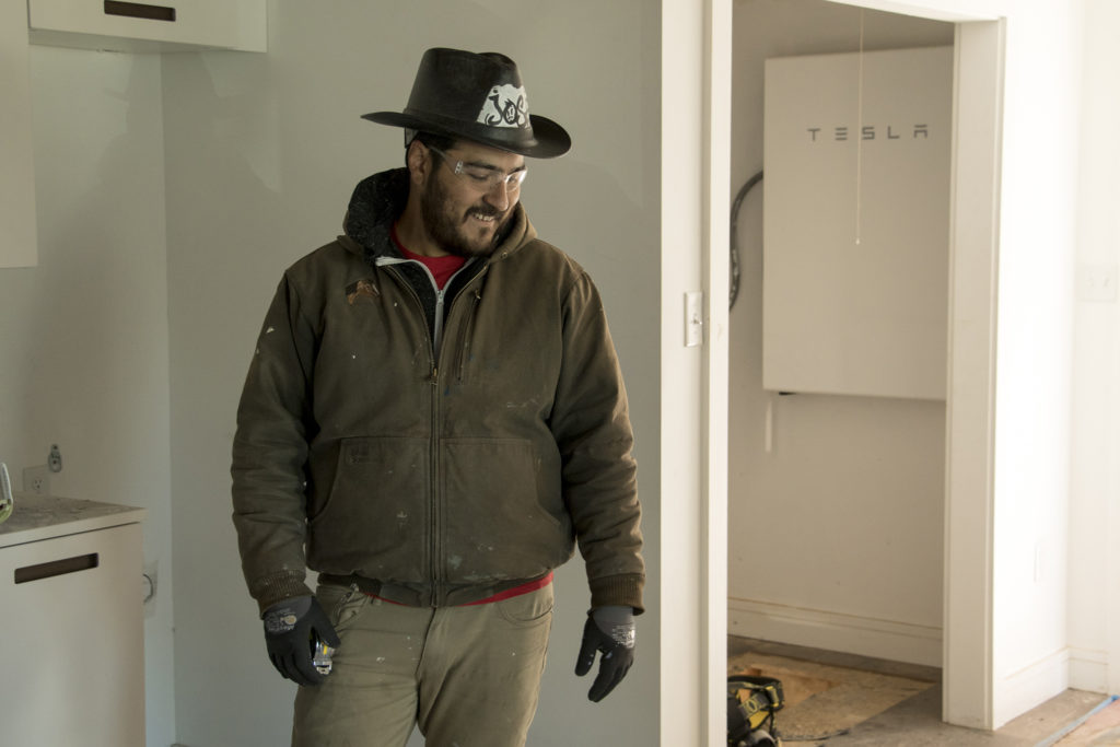Jose Elizondo speaks ot a reporter inside a solar home under construction at Habitat for Humanity's College View neighborhood site, Dec. 20, 2018. (Kevin J. Beaty/Denverite)