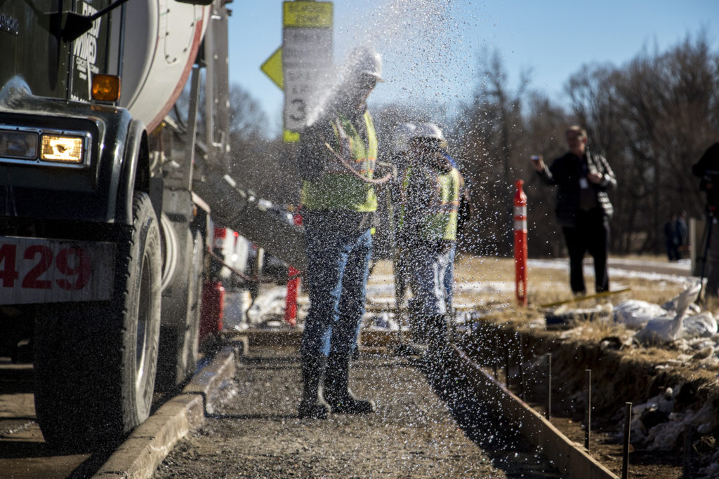 The first sidewalks of the 2017 GO bond funds are poured in Bear Valley, Jan. 3, 2019. (Kevin J. Beaty/Denverite)