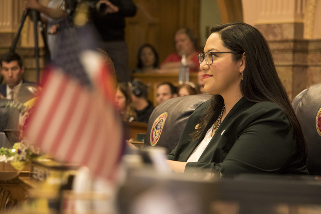 Newly-elected district 34 Senator Julie Gonzales smiles as the new class of officials is read allowed on the first day of the new legislative session on Jan. 4, 2019. (Kevin J. Beaty/Denverite)