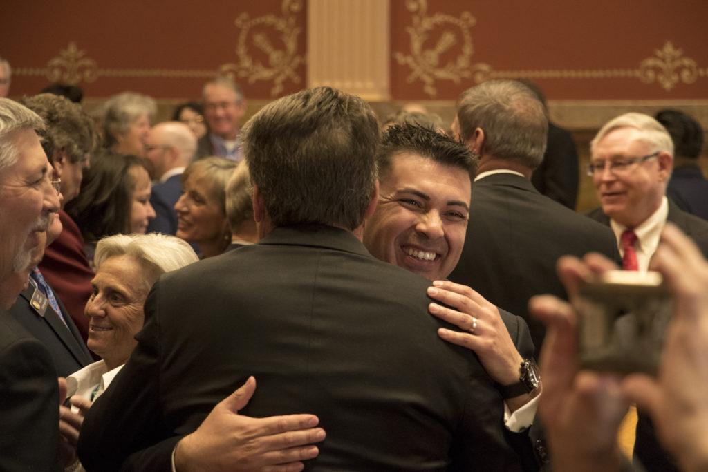 Newly-elected Senate President Leroy Garcia hugs Senator Jerry Sonnenberg on the first day of the 2019 legislative session, Jan. 4, 2018. (Kevin J. Beaty/Denverite)