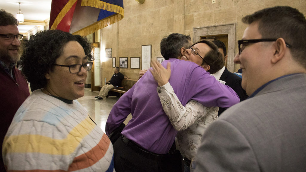 """Denver City Councilwoman Robin Kniech greets supporters after a bill banning """"conversion therapy"""" was passed, Jan. 7, 2018. (Kevin J. Beaty/Denverite)"""