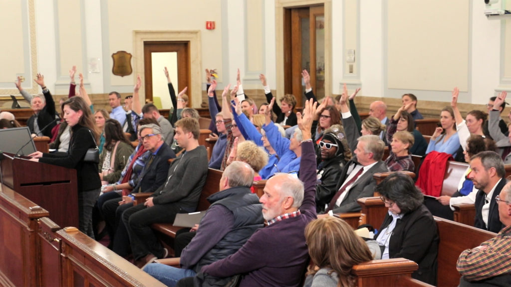 Everyone opposing a bill to rezone in Hilltop raises their hands for City Council to see, Jan. 7, 2018. (Kevin J. Beaty/Denverite)