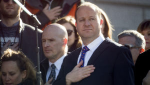 Jared Polis holds his hand over his heart during the National Anthem before he is inaugurated as Colorado's 43rd governor, Jan. 8, 2018. (Kevin J. Beaty/Denverite)