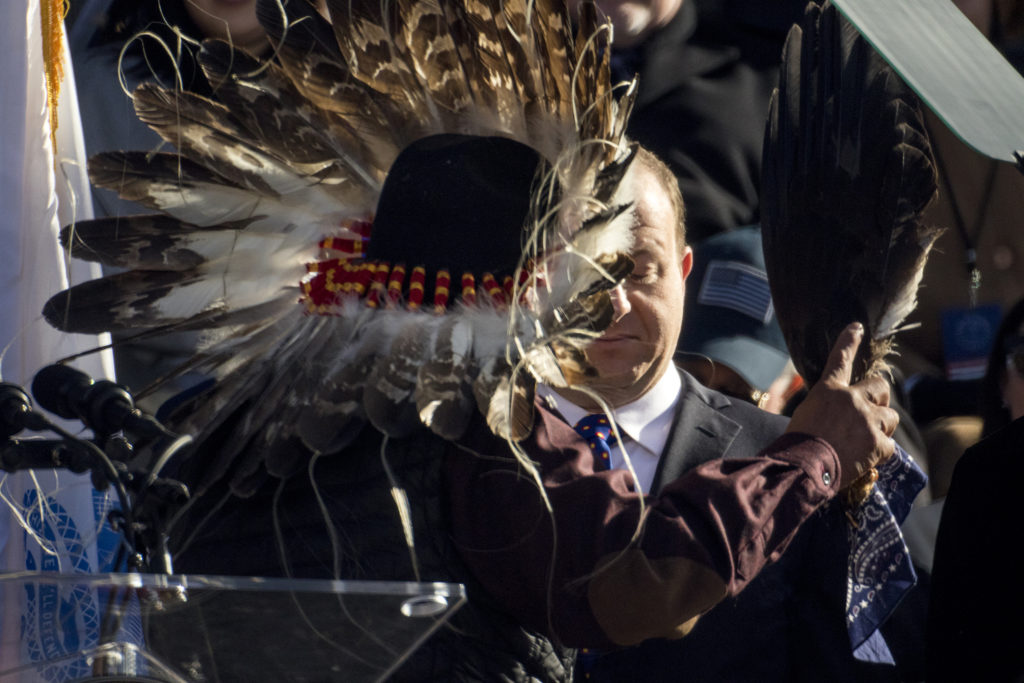 Terry Knight, representing the Ute Mountain Ute tribe, smudges Jared Polis before he is inaugurated as Colorado's 43rd governor, Jan. 8, 2018. (Kevin J. Beaty/Denverite)