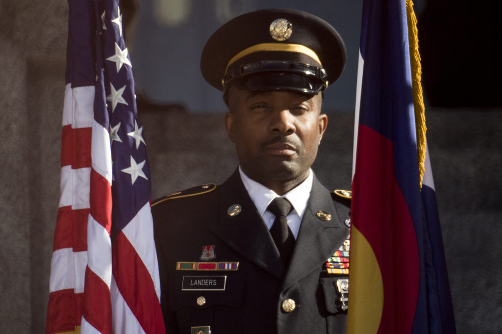 A member of a military color guard stands at attention during Jared Polis' inauguration as Colorado's 43rd governor, Jan. 8, 2018. (Kevin J. Beaty/Denverite)