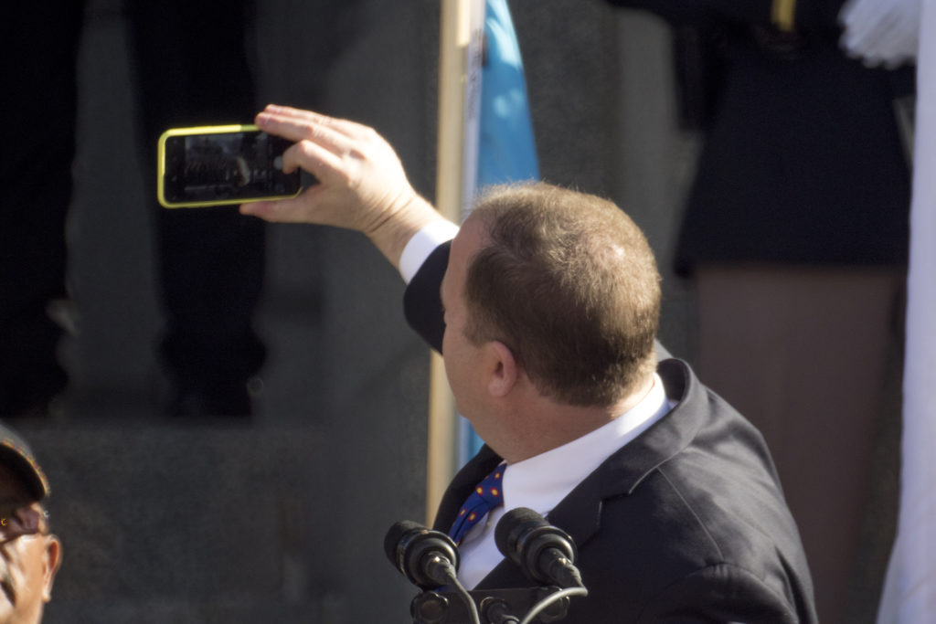 Jared Polis takes a selfie after he was inaugurated as Colorado's 43rd governor, Jan. 8, 2018. (Kevin J. Beaty/Denverite)
