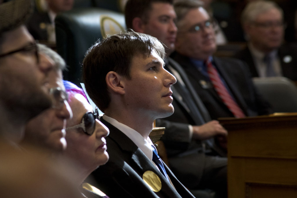 Marlon Reis, the first gentleman, listens as Governor Jared Polis gives his first State of the State address, Jan. 10, 2019. (Kevin J. Beaty/Denverite)
