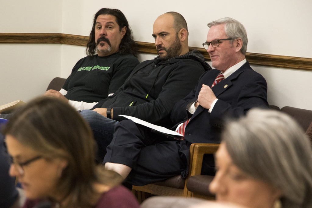 Nick Rogers, president of the Denver Police Protective Assocation (left), listens as Denver City Council's Safety, Housing, Education, & Homelessness Committee meets to discuss expanded powers for the Office of the Independent Monitor, Jan. 16, 2019. (Kevin J. Beaty/Denverite)