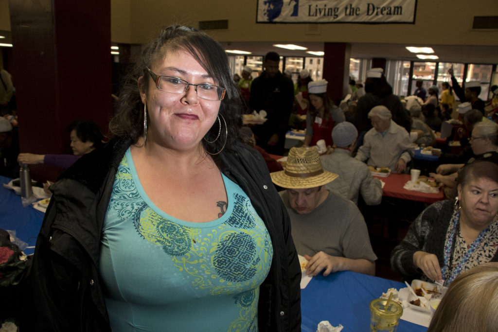 Tiffany Muñoz poses for a portriat. Volunteers of America hosts their annual Martin Luther King Jr. Day dinner, Jan. 21, 2019. (Kevin J. Beaty/Denverite)