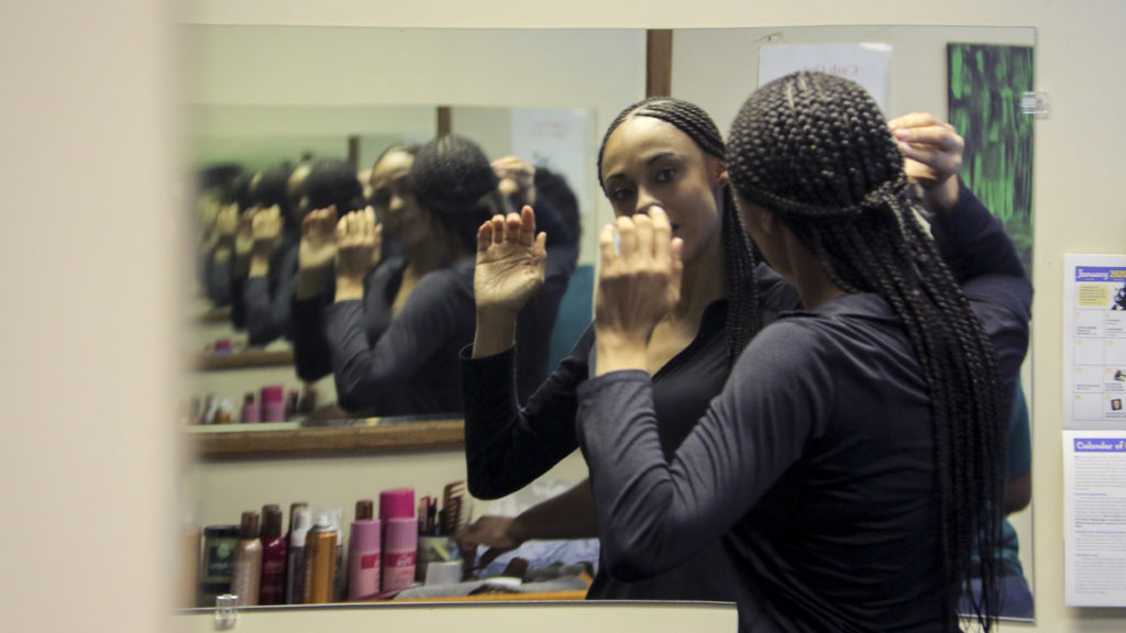 Elisabeth Epps gets her hair done the day before she's due in court for sentencing, Jan. 22, 2019. (Kevin J. Beaty/Denverite)