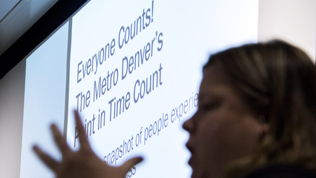 Volunteers train to help take the annual Point-In-Time survey of homelessness at an Adams County government building, Jan. 22, 2019. (Kevin J. Beaty/Denverite)