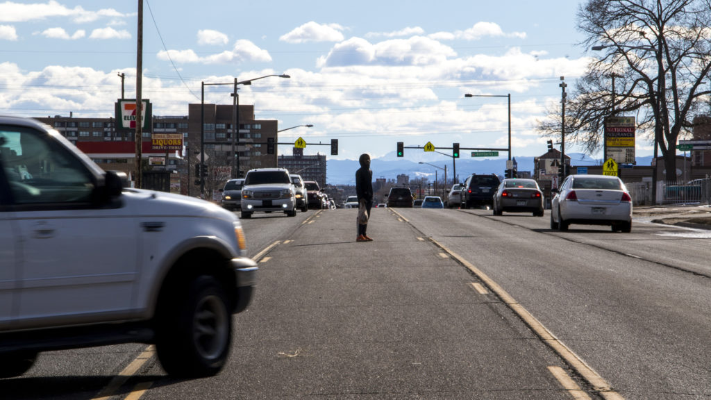 A pedestrian attempts to cross Federal Boulevard, Jan. 26, 2019. (Kevin J. Beaty/Denverite)