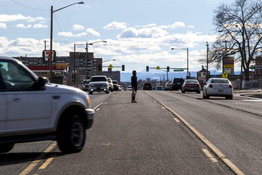 A pedestrian attempts to cross Federal Boulevard, Jan. 26, 2019. (Kevin J. Beaty/Denverite)