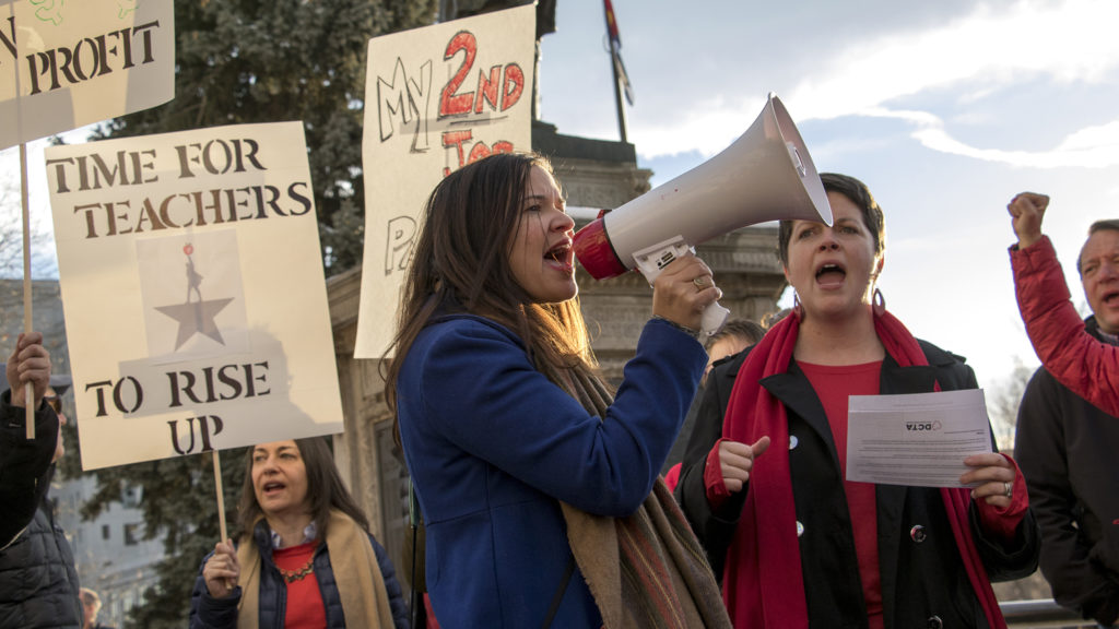 Yasiris Torres, a Spanish teacher at George Washington High School, leads cheers during a protest to support higher wages for Denver's teachers at the Colorado Capitol building, Jan. 30, 2019. (Kevin J. Beaty/Denverite)