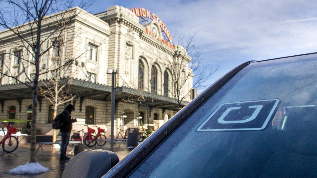 An Uber waits for a passenger outside of Union Station, Dec. 31, 2019. (Kevin J. Beaty/Denverite)
