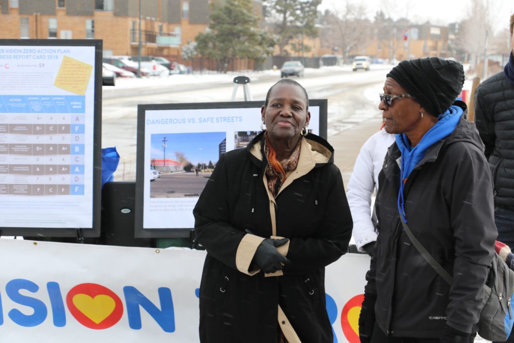 Ann White, chair of the Montbello 20/20 neighborhood organization, stands next to Pam Jiner, founder of Montbello Walks, at a press conference. (David Sachs)