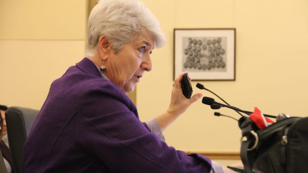 State Sen. Lois Court of Denver holds a cell phone up during a Senate Transportation & Energy committee meeting on Thursday, Jan. 24, 2019, at the Capitol. (Esteban L. Hernandez/Denverite)