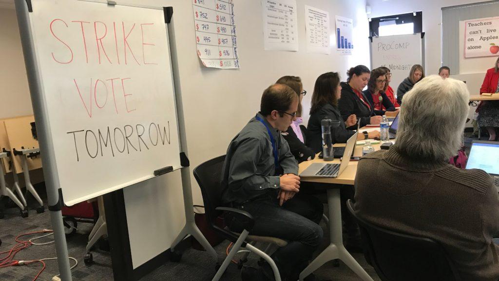 Denver Public Schools officials and Denver Classroom Teachers Association members meet during negotiating on Friday, Jan. 18, 2019, at the Acoma Campus in Denver. (Esteban L. Hernandez/Denverite)