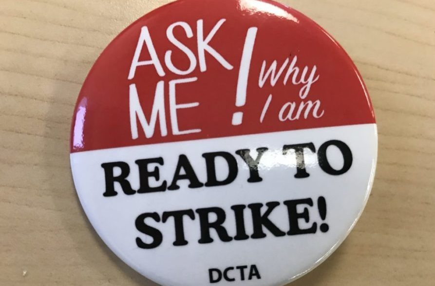 Some Denver teachers are wearing these buttons, provided by the union, at the teacher pay negotiations. (Chalkbeat)