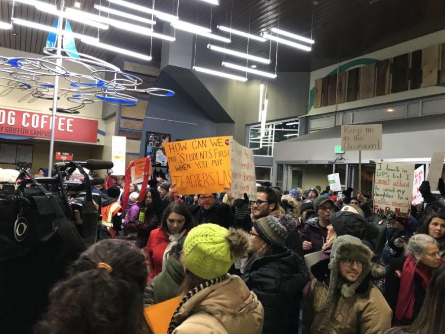 Denver teachers pack the lobby of the district headquarters to demand fair pay. (Melanie Asmar/Chalkbeat)