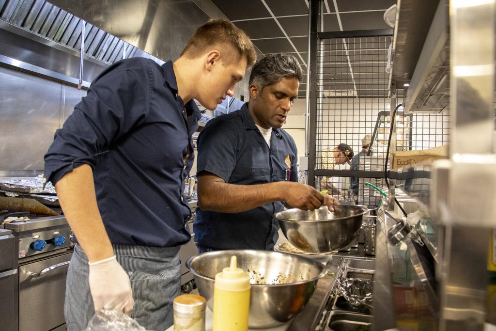 Biju Thomas at work inside Biju's Little Curry Shop Grill at Broadway Market, February 20, 2019. (Kevin J. Beaty/Denverite)