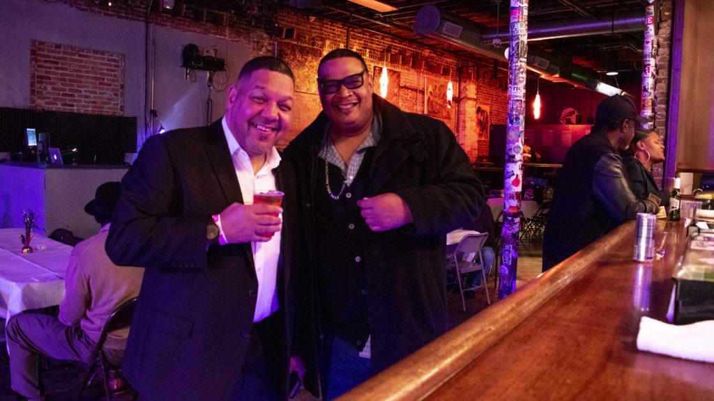 Randall Borne (left) and DJ Sonny P pose for a portrait during a fundraiser for Borne's business at Cervantes' Other Side on Welton Street, Feb. 2, 2019. (Kevin J. Beaty/Denverite)