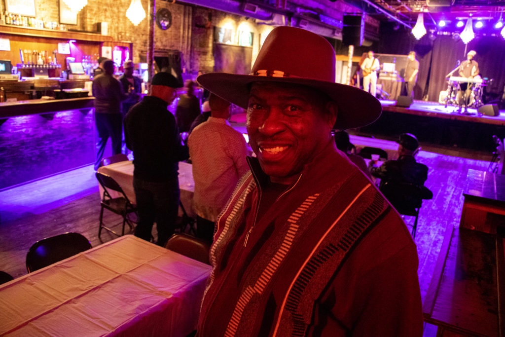 """Edward """"Too Tall"""" Walker poses for a portrait. A fundraiser for Randall Borne at Cervantes' Other Side on Welton Street, Feb. 2, 2019. (Kevin J. Beaty/Denverite)"""