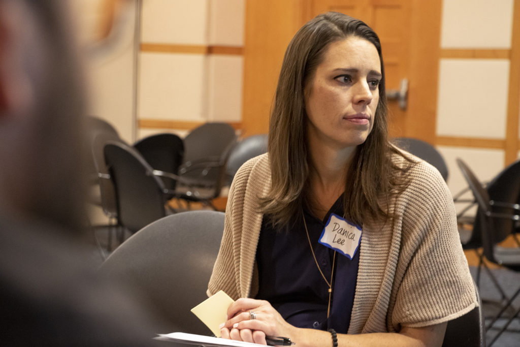 Danica Lee, a division director with the Denver Department of Public Health and Environment, listens during a breakout session during Denver's Road Home's annual Giver's Summit, Feb. 5, 2019. (Kevin J. Beaty/Denverite)