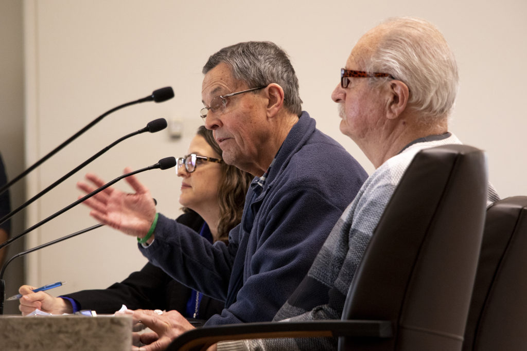 David DeJiacomo (right) and Robert Fox testify to Colorado's House Health & Insurance Committee on a bill that would make it easier for people to change gender designation on their birth certificates, Feb. 6, 2019. (Kevin J. Beaty/Denverite)
