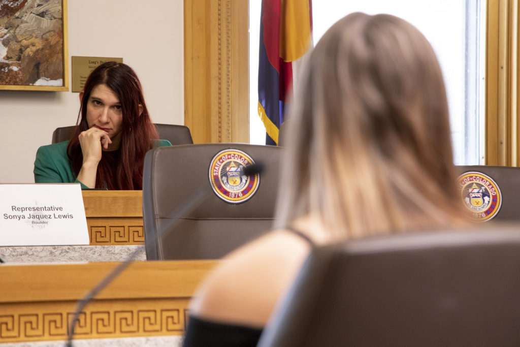 27th District Representative Brianna Titone listens as Colorado's House Health & Insurance Committee hears testimony on a bill that would make it easier for people to change gender designation on their birth certificates, Feb. 6, 2019. (Kevin J. Beaty/Denverite)