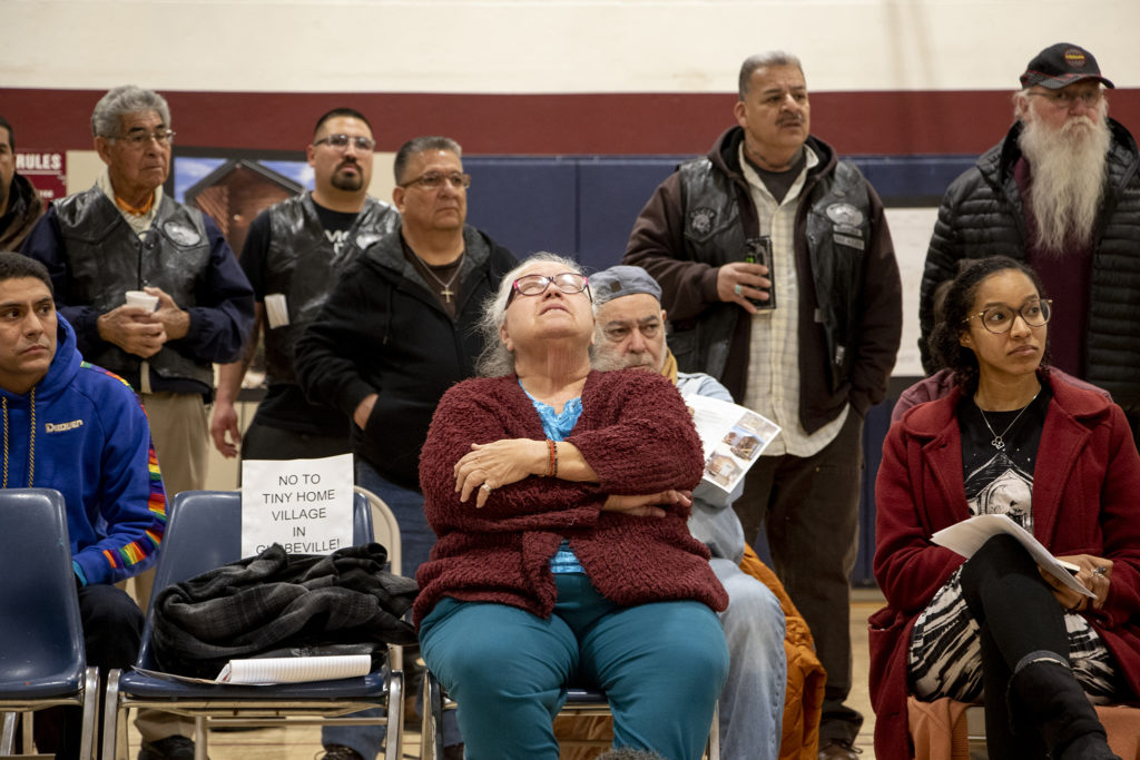Toni Riley closes her eyes in frustration as globeville residents meet with representatives from the city and the Beloved Community tiny home village, Feb. 7, 2019. (Kevin J. Beaty/Denverite)