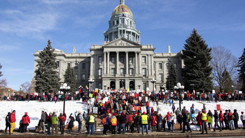 Denver teachers rally on the Captiol steps during the first day of their strike, Feb. 11, 2019. (Kevin J. Beaty/Denverite)