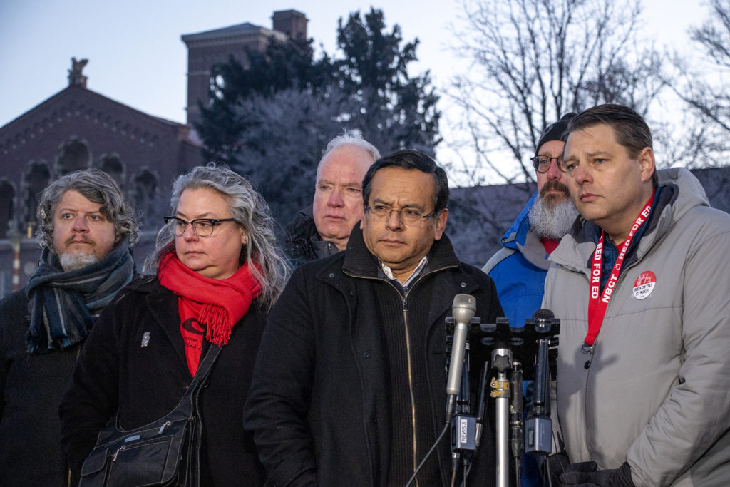 Lead negotiator Rob Gould (from right), and Denver Classroom Teachers Association President Henry Roman speak to the press. Day one of the Denver teachers' strike at South High School, Feb. 11, 2019. (Kevin J. Beaty/Denverite)