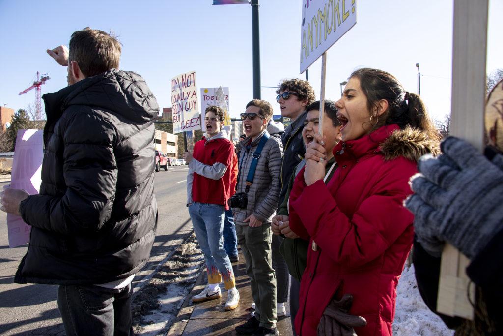 Jocelyn Arguelles (right), a senior at the Denver Center for International studies, pickets alongside instructors on day two of the Denver teachers strike, Feb. 12, 2019. (Kevin J. Beaty/Denverite)