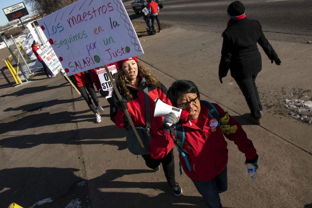 Maribel Villanueva, a first grade teacher at College View Elementary, leads chants outside of Lincoln High School on day two of the Denver teachers strike, Feb. 12, 2019. (Kevin J. Beaty/Denverite)