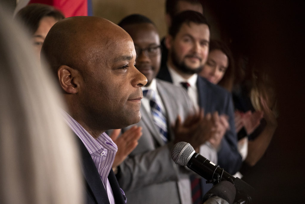 Mayor Michael hancock announces a city bill to increase minimum wage for city workers, Feb. 14, 2019. (Kevin J. Beaty/Denverite)